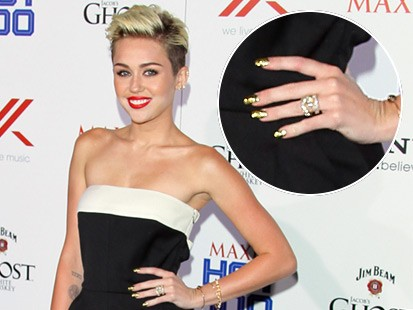 Miley Cyrus: Her Engagement Ring Is On Again!