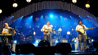 PHOTO: Ben Lovett, Marcus Mumford and Wynston Marshall of Mumford & Sons perform on stage at 02 Arena, Dec. 11, 2012 in London.