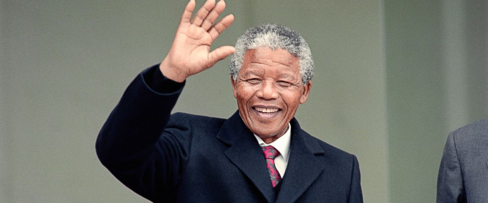 PHOTO: South African anti-apartheid leader Nelson Mandela waves to the press as he arrives at the Elysee Palace, June 7, 1990, in Paris, to have talks with French president Francois Mitterrand.