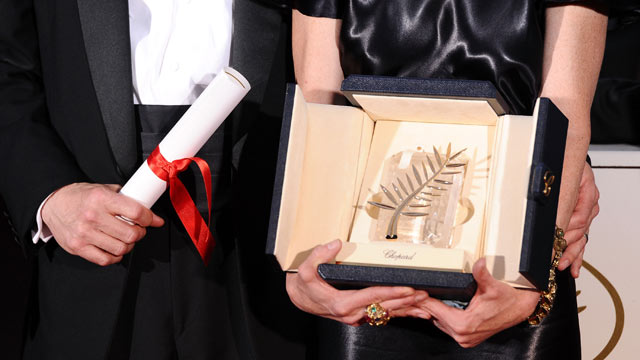 PHOTO: The Palme d'Or at the Cannes Film Festival is presented to producers Bill Pohlad (L) and Dede Gardner (R) for 'The Tree of Life' at the Palme d'Or Winners Photocall at the Palais des Festivals during the 64th Cannes Film Festival on May 22, 2011