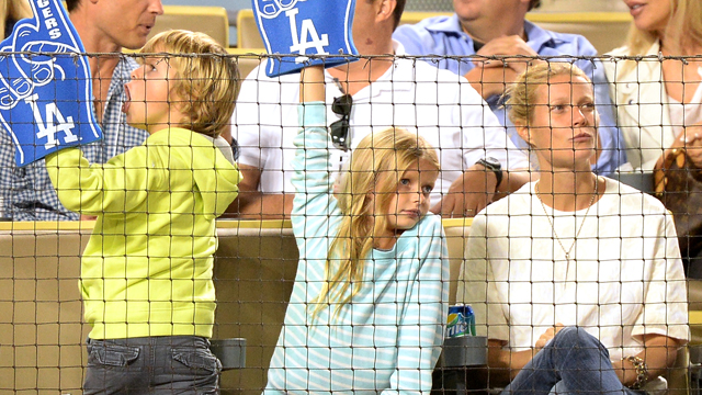 PHOTO: Actress Gwyneth Paltrow and her family watch the game between the Arizona Diamondbacks and the Los Angeles Dodgers at Dodger Stadium on Sept. 11, 2013 in Los Angeles.