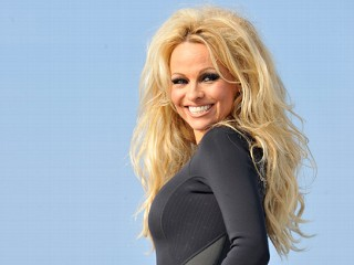 Photos: Pamela Anderson Sports Black Wetsuit