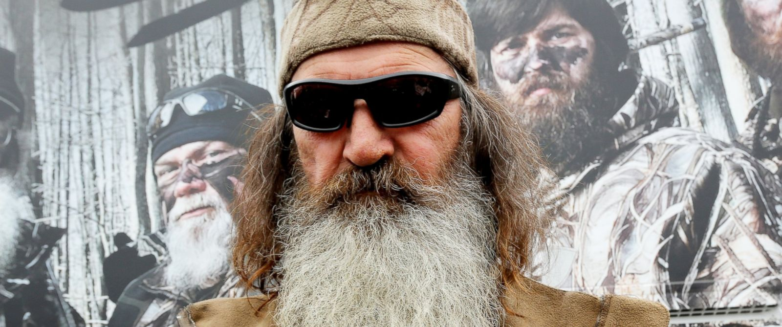 PHOTO: Reality TV personality Phil Robertson greets fans in the Duck Commander Compound at Texas Motor Speedway on April 5, 2014 in Fort Worth, Texas.