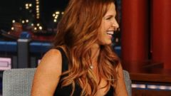 PHOTO: Actress Poppy Montgomery from the CBS drama series Unforgettable shares a laugh with Dave on the Late Show with David Letterman, July 9, 2014 on the CBS Television Network.