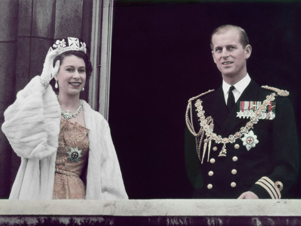 PHOTO:Queen Elizabeth II waving from the balcony at Buckingham Palace with her husband Prince Philip Duke of Edinburgh in 1953.