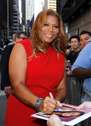 Queen Latifah Flashes a Smile in NYC