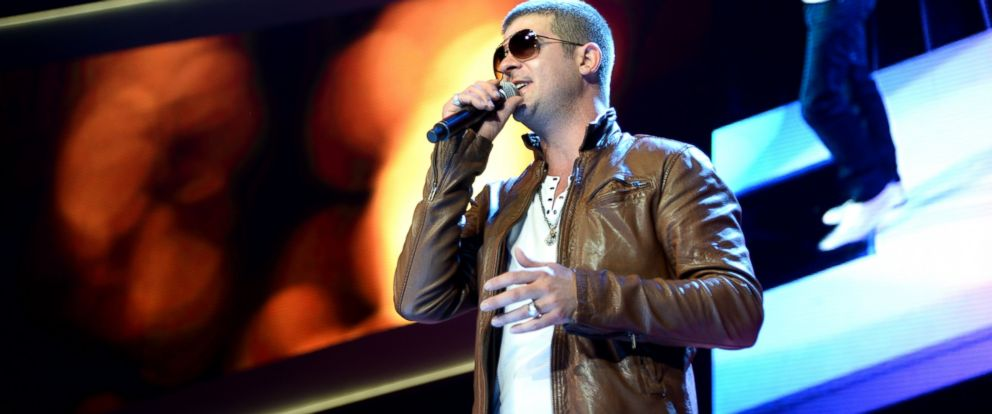 PHOTO: Robin Thicke performs during the Walmart 2014 annual shareholdersmeeting on June 6, 2014 at Bud Walton Arena at the University of Arkansas in Fayetteville, Arkansas.