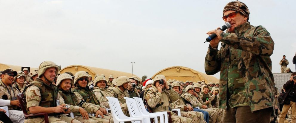 PHOTO: Actor/comedian Robin Williams entertains the troops during the United Service Organizations (USO) tour at Baghdad International Airport on Dec. 16, 2003.