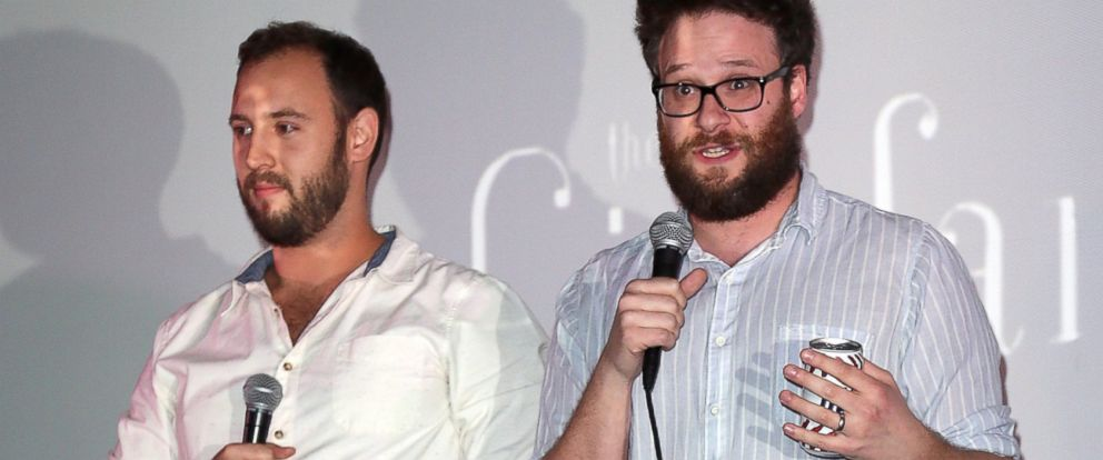 """PHOTO: Writers/directors Evan Goldberg, left, and Seth Rogen introduce the screening of Sony Pictures """"The Interview"""" at Cinefamily, Dec. 25, 2014 in Los Angeles, California."""