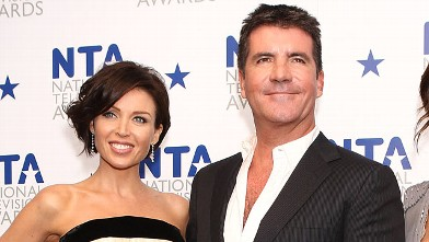 PHOTO:Simon Cowell is shown with Dannii Minogue at The O2 Arena, Jan. 20, 2010 in London, England.