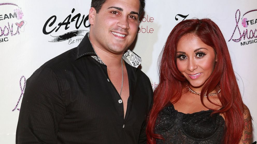 PHOTO: Jionni LaValle and Nicole Snooki Polizzi attend a birthday party held in Snookis honor at Cavo, Dec. 6, 2013 in New York City.