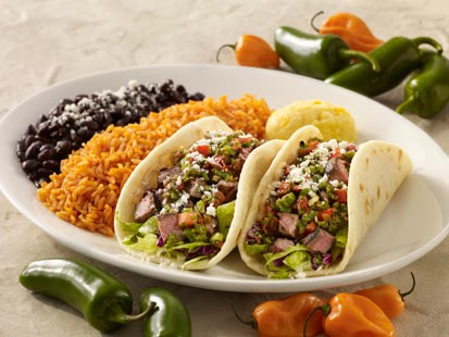 Cat Cora's grilled chili-lime flank steak soft tacos are shown h
