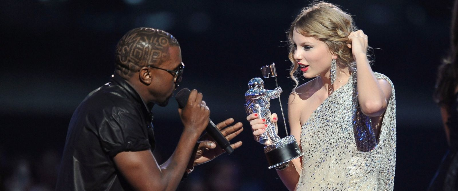 PHOTO: Kanye West takes the microphone from Taylor Swift and speaks onstage during the 2009 MTV Video Music Awards on Sept. 13, 2009, in New York City.