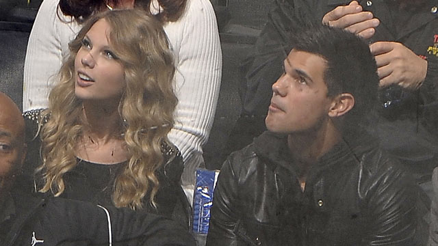 PHOTO: Taylor Lautner and Taylor Swift attend the NHL game between the Columbus Blue Jackets and the Los Angeles Kings during the game on October 25, 2009 at Staples Center in Los Angeles, Calif.