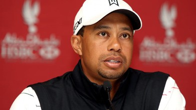 PHOTO: Tiger Woods speaks with the media prior to the start of the Abu Dhabi HSBC Golf Championship at the Abu Dhabi Golf Club, Jan. 24, 2012 in Abu Dhabi, United Arab Emirates.