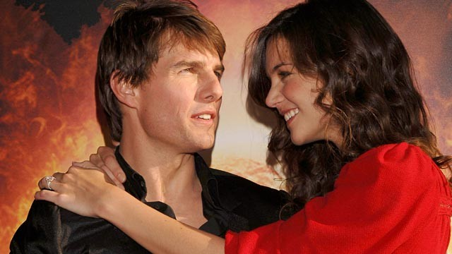 "Tom Cruise and then-fiancée Katie Holmes arrive at the Spanish premiere of the film ""War of the Worlds"" at the Palacio de la Musica cinema in Madrid, June 21, 2005."