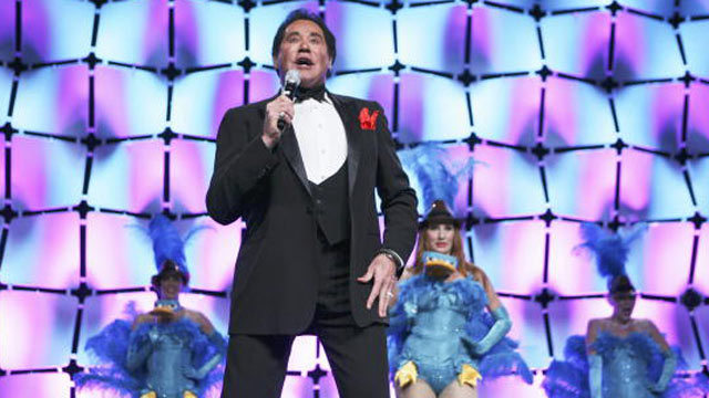 """PHOTO: Wayne Newton performs the theme song to """"Phineas and Ferb"""" at Disneys presentation to licensees and retailers at the Licensing International Expo 2010 in Las Vegas."""