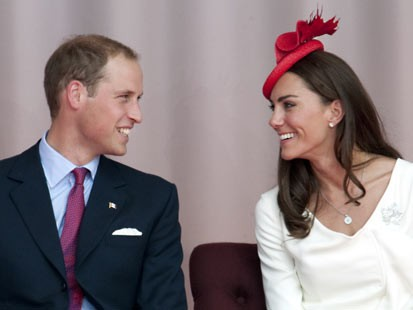 PHOTO: Britain's Prince William and his wife Catherine, Duchess of Cambridge, celebrate Canada Day on Parliament Hill in Ottawa, July 1, 2011 during their first official foreign trip as husband and wife.