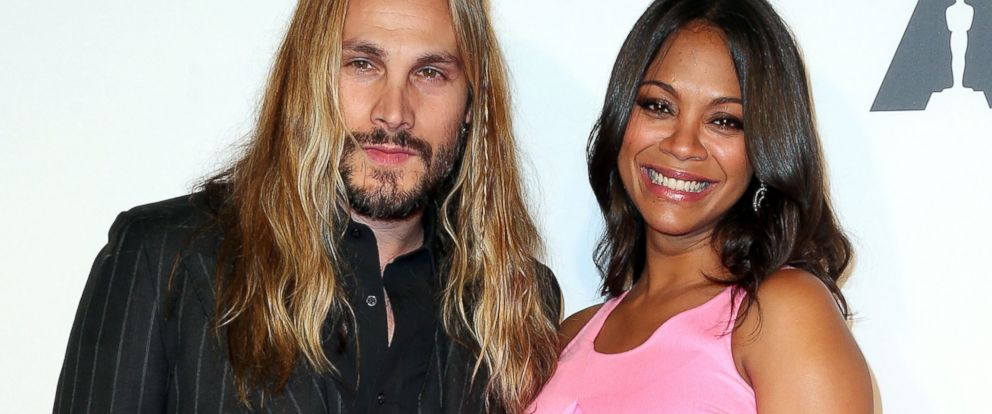 PHOTO: Marco Perego and Zoe Saldana attend The Academy of Motion Picture Arts and Sciences Hollywood Costume Opening Party at the Wilshire May Company Building on Oct. 1, 2014 in Los Angeles, Calif.