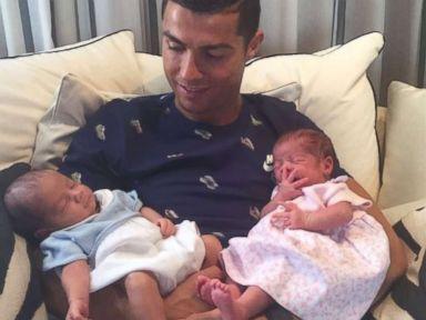 Soccer star Cristiano Ronaldo introduces his newborn twins