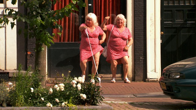 PHOTO: Louise and Martine Fokkens are two of Amsterdam's beloved prostitutes and they happen to be twins with 40+ years of experience.