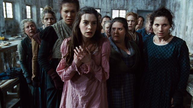 "PHOTO: This undated publicity photo provided by Universal Pictures shows Anne Hathaway, left, as Fantine, being thrown out of the factory in a scene from director, Tom Hooper's new film, ""Les Miserables,"" the motion-picture adaptation of the beloved globa"