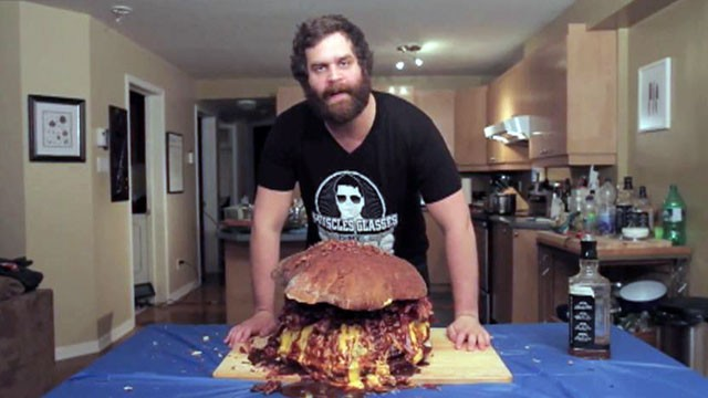 "PHOTO: Epic Meal Time's Harley Morenstein with the ""Boss Bacon Burger,"" which includes ground bacon, stuffed with bacon, covered in bacon sauce and topped with bacon strips."