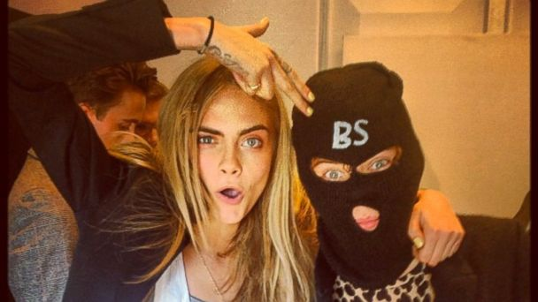PHOTO: Cara Delevingne posted this image backstage at the Burberry show with Harry Styles, Sept. 16, 2013.