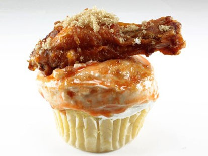 Coccadotts Cake Shop is selling a cupcake made of cornbread and blue cheese frosting with a chicken wing on top.