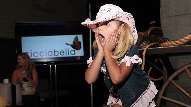 "PHOTO: ""Toddlers and Tiaras"" star Eden Wood modeled boots from Ciccibellas Cowgirl Riders line at New York Citys Bryant Park Hotel on Sept. 15, 2011."