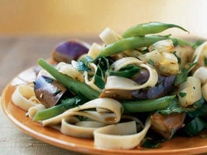 Cooking Light's eggplant and onion noodle salad with warm soy-rice vinaigrette is shown here.