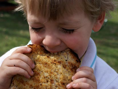 Erin Chase's son is shown here eating grilled garlic bread.
