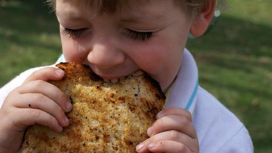 PHOTO: Erin Chase's son is shown here eating grilled garlic bread.