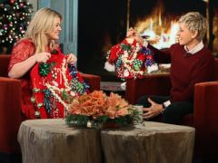 PHOTO: Kelly Clarkson appears on The Ellen DeGeneres Show,  Dec. 6, 2013, where Ellen surprises her with an ugly sweater and a matching one for her baby.