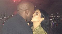 Kim Kardashian Shares a Fireworks Smooch with Kanye West