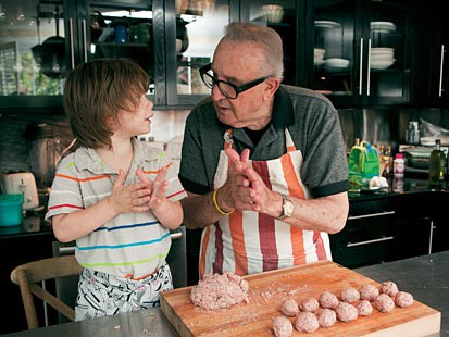 PHOTO: Marc Vetris father and son prepare the family meatball recipe together.
