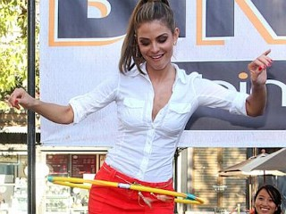Photos: Menounos Hula-Hoops With New Hairdo