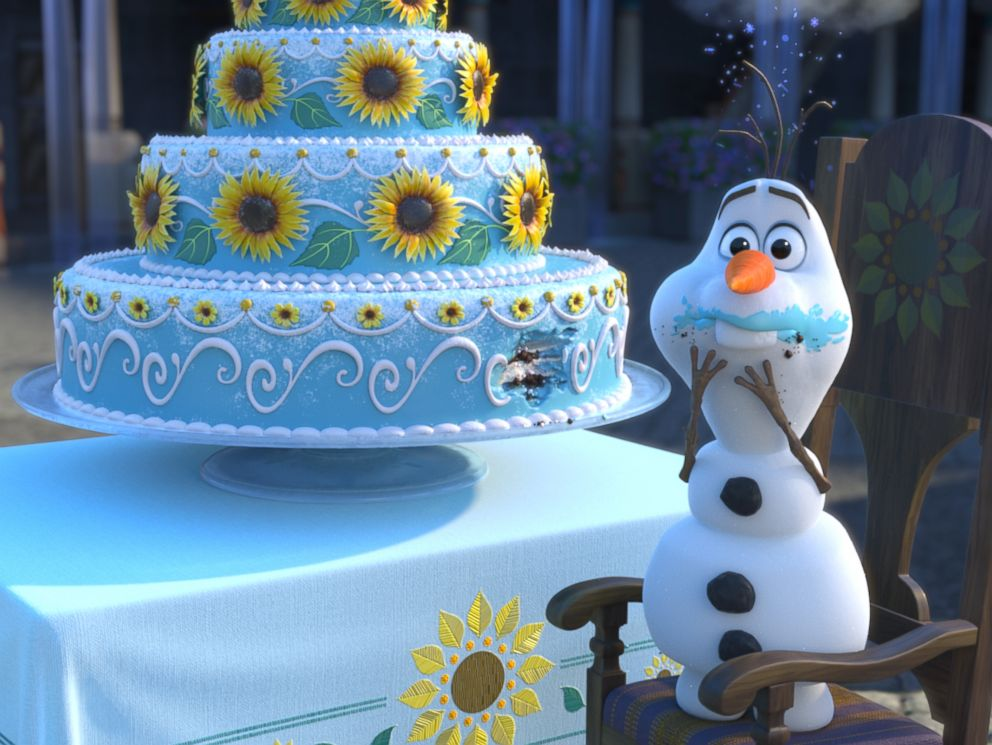 PHOTO: Olaf sneaks a taste of Annas birthday cake in Frozen Fever, a short from Disney.