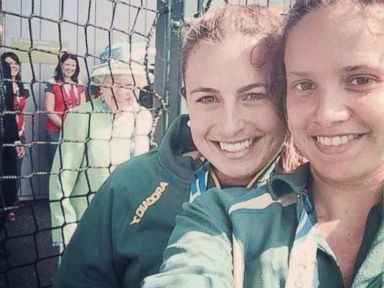 Queen Elizabeth Photobombs Hockey Players