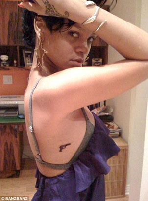 handgun tattoo below her armpit, according to Web Site Bang Bang Tattoo.