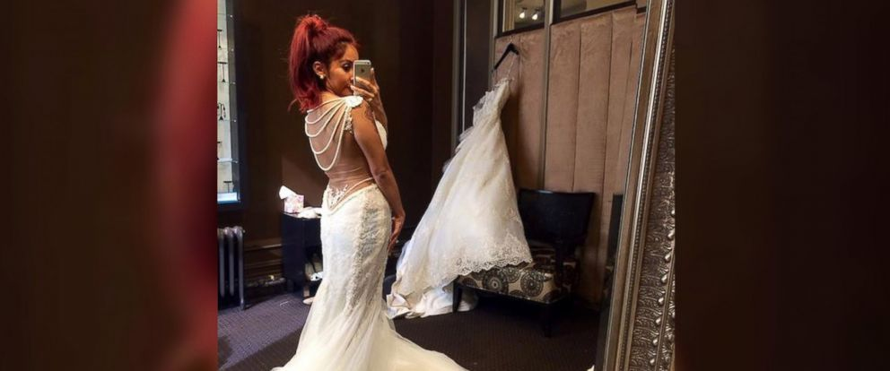 "PHOTO: Nicole Polizzi, known as Snooki, posted this self-portrait to her Facebook page on May 29, 2014 with the caption, ""My wedding dress update..."""