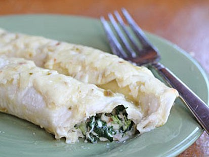 Erin Chase's make-ahead chicken and spinach enchiladas are shown here.
