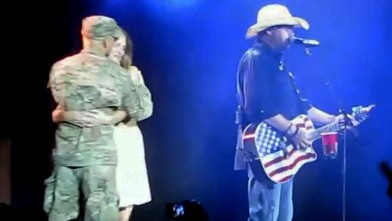 PHOTO: Toby Keith brought a military wife up on stage at a concert in Houston, Texas to reunited with her husband who had been away in Afghanistan on Sept. 8, 2012.