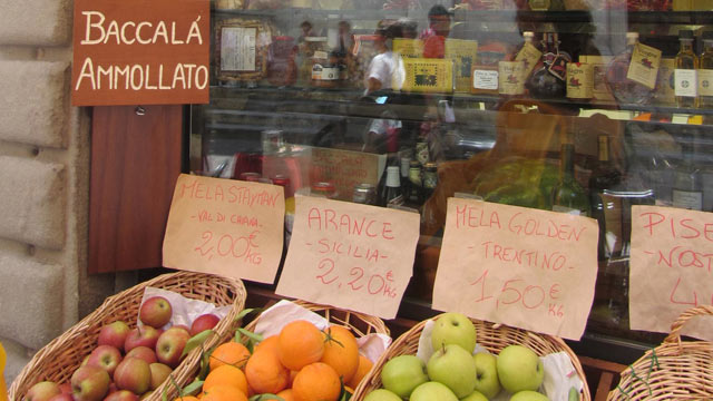 PHOTO: Here is a market selling the four food groups of Italy: bread, wine, olive oil and cheese.