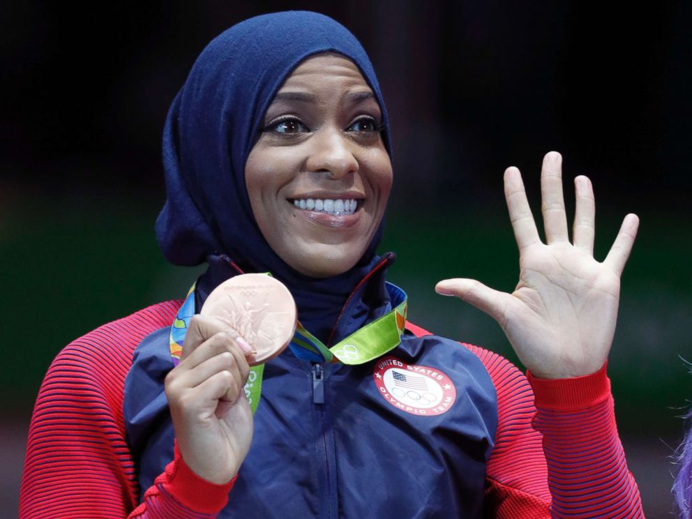 PHOTO: Ibtihaj Muhammad of the U.S. pose with her bronze medals on the podium after the womens team sabre fencing event at the 2016 Summer Olympics, in Rio de Janeiro, Brazil, Aug. 13, 2016.