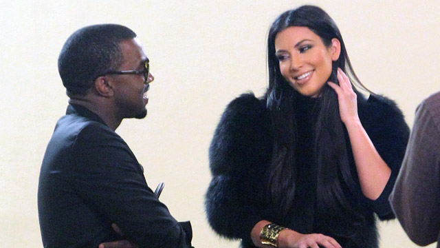 PHOTO: Kim Kardashian and chats with Kanye West at the new Dash store