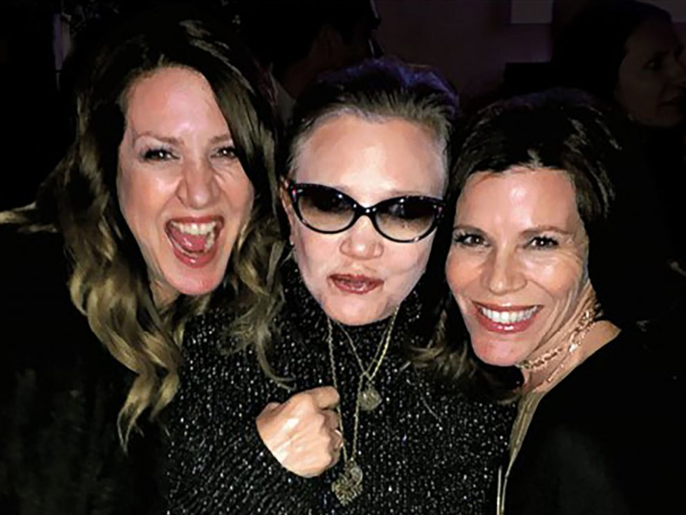 PHOTO: Joely Fisher, left, poses with her sisters Carrie Fisher, center, and Tricia Fisher, right.