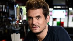 'PHOTO: John Mayer sits for a portrait on June 27, 2017 in New York.' from the web at 'http://a.abcnews.com/images/Entertainment/john-mayer-01-gty-jc-180112_16x9t_240.jpg'