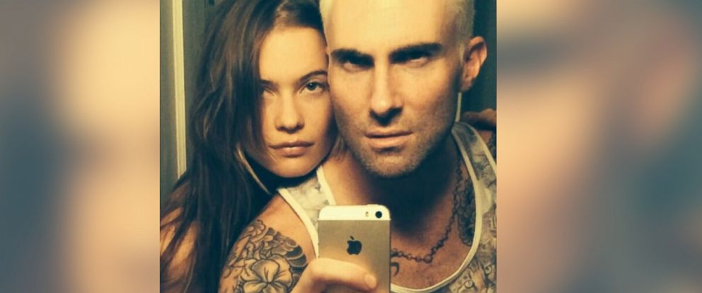 PHOTO: Adam Levine shows off his new hair color alongside fiancée Behati Prinsloo, May 3, 2014.