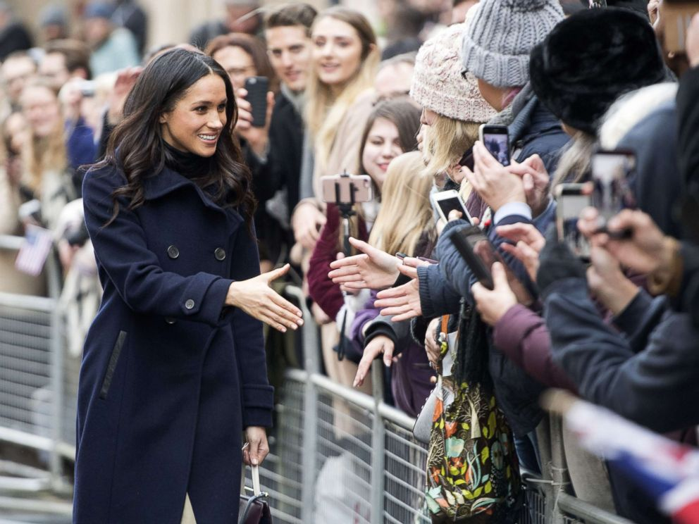 PHOTO: Meghan Markle greets the crowd as she and Prince Harry visit the Terrence Higgins Trust World AIDS Day Charity Fair in Nottingham, England, Dec. 1, 2017.